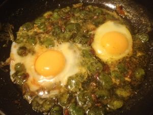Eggs cooking in Braod Beans